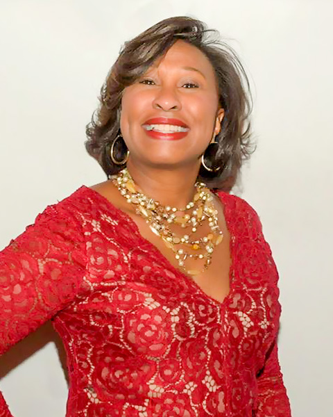 Sheila D. McKoy in a red evening dress